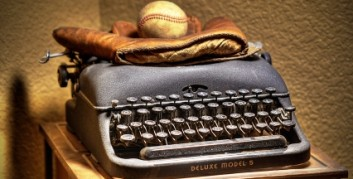 baseball glove on typewriter