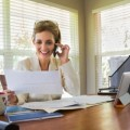 blond woman phone desk paperwork