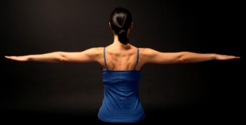 back of woman arms outstretched