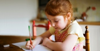 young-girl-writing-at-desk-353
