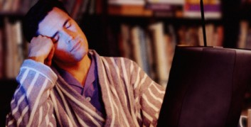 Telecommuter Sleeping at His Laptop