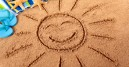 sun drawn in sand