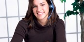 woman with headset and planner