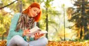 redhead outside leaves book
