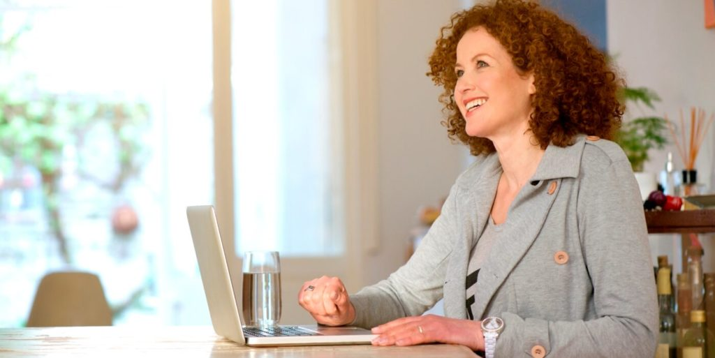 Job seeker learning how to succeed in her telecommuting job search.