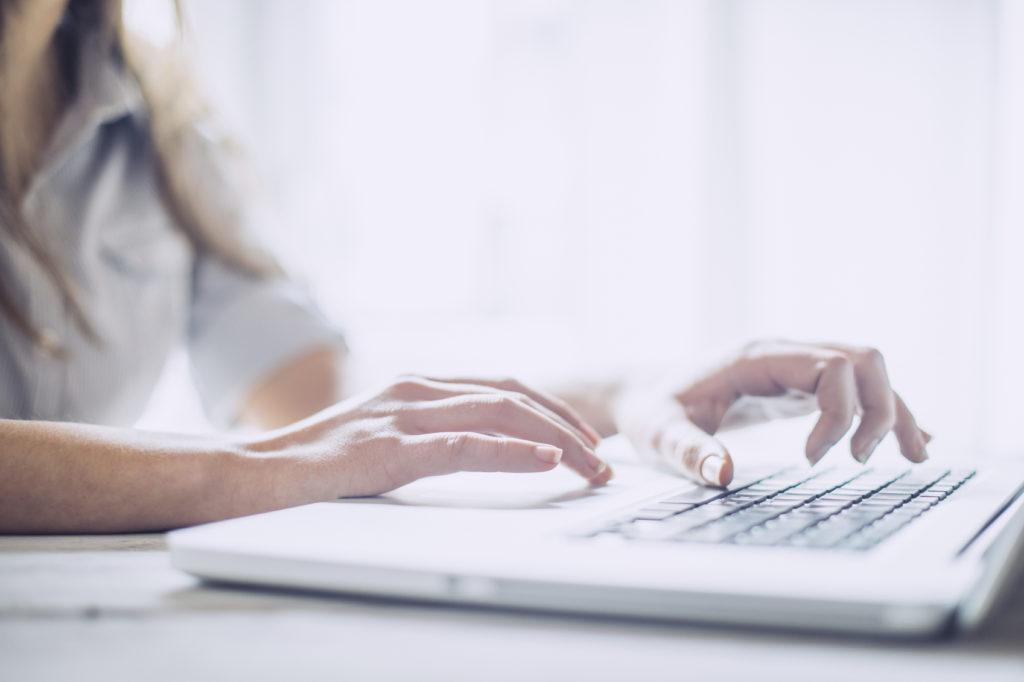 Job seeker writing a new resume
