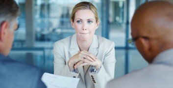 job interview blond woman resume 2 men