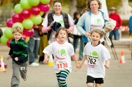 Kids and moms running, participating in community education