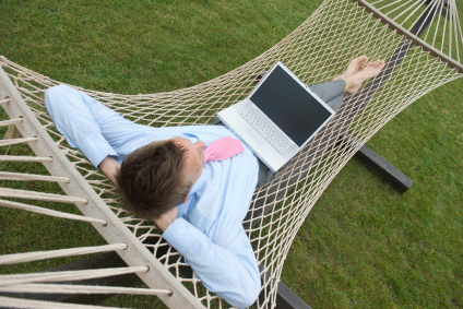 man in hammock laptop