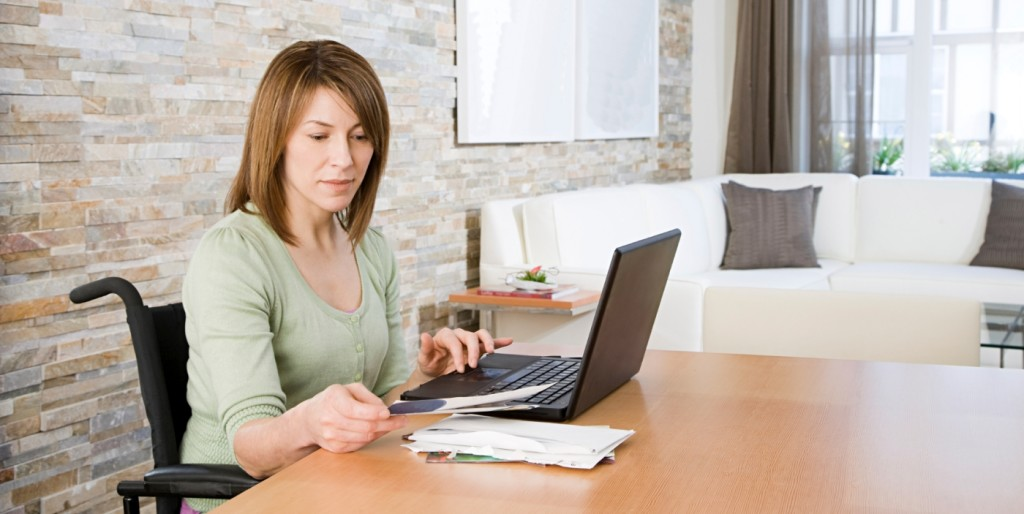 Employer at desk looking for traits remote companies want in a job candidate