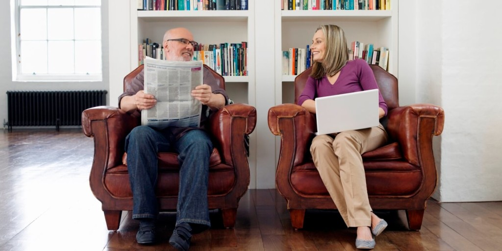 Couple reading the latest flexible work news on how to land your dream job