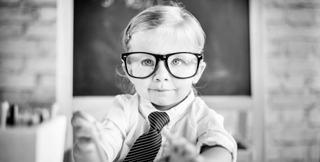 Picture of a child in a tie thinking about his dream job
