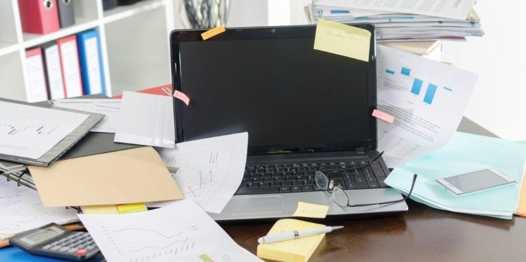 The desk of a job seeker looking for flexible project coordinator jobs