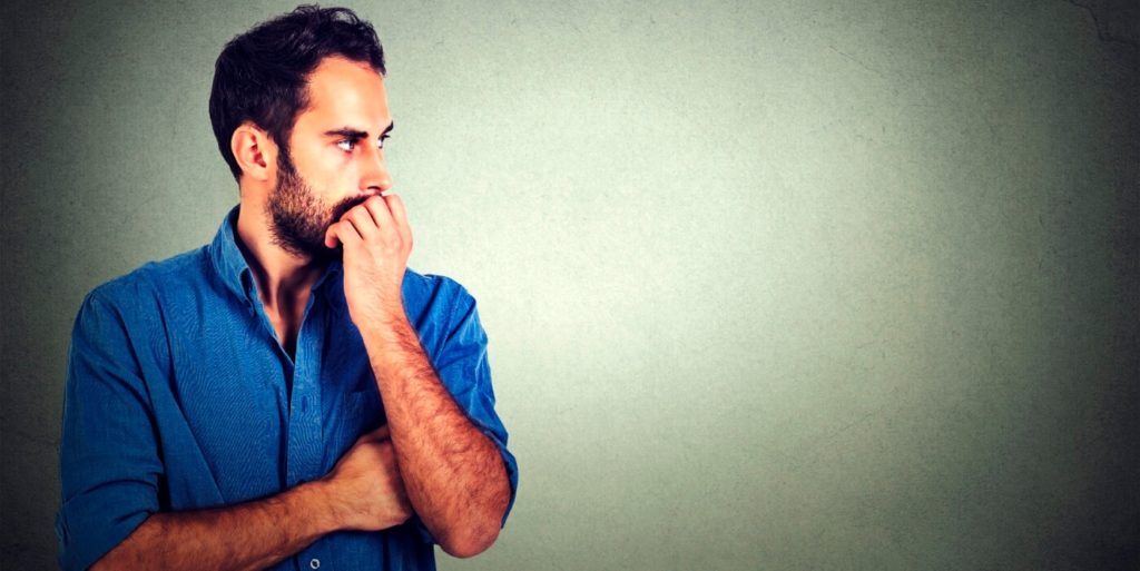 Male job seeker standing and pondering the job seeker's guide to mindfulness