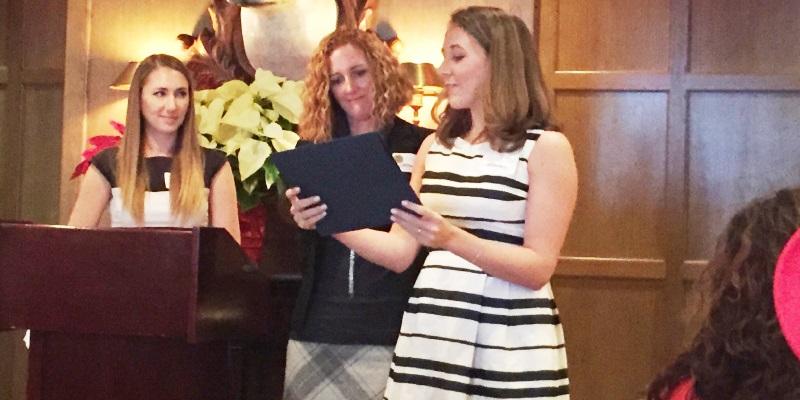 Kristin receiving the Community Builder Award
