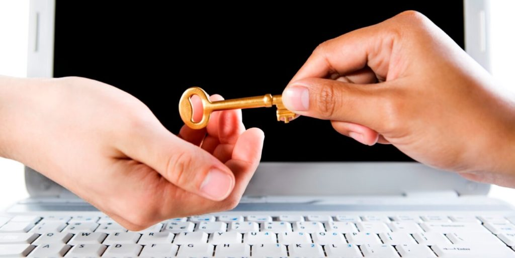 Hands exchanging a key, symbolizing the start of a career legacy