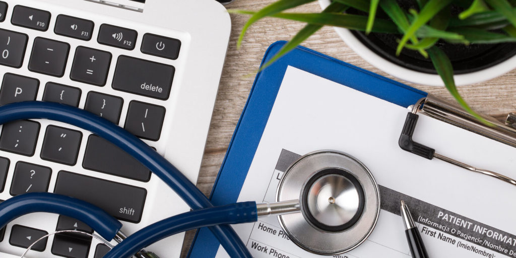 Laptop with stethoscope for the top companies for remote jobs in healthcare.
