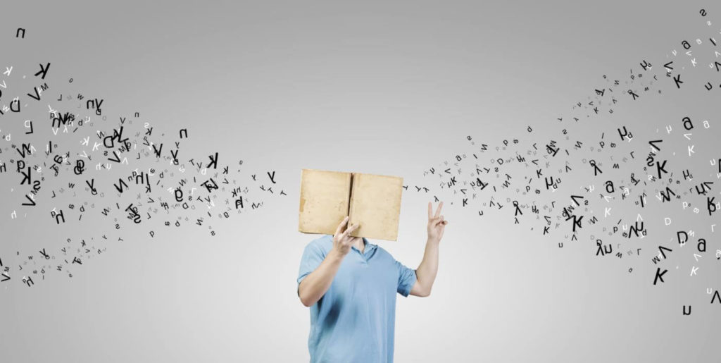 Job seeker holding up a book, increasing career literacy.