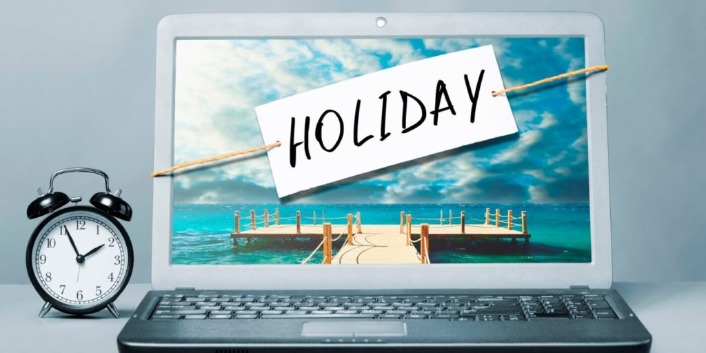 Laptop with a holiday sign on it to take a vacation.