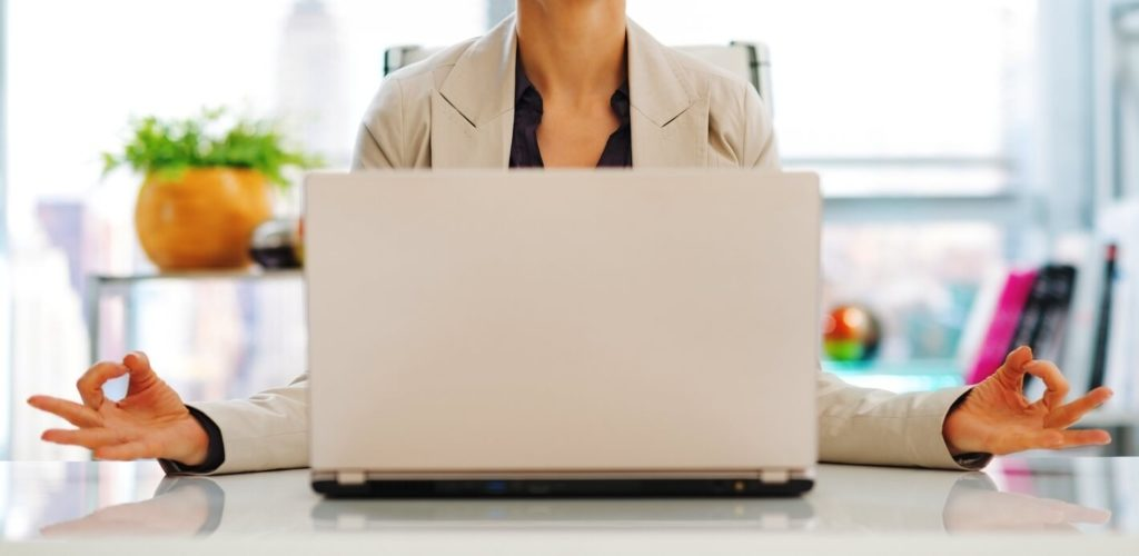 Worker on her laptop trying to get ahead at work without overworking.