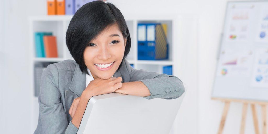 Employee enjoying her virtual admin job.