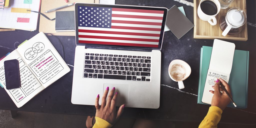 Military spouse on a laptop to consider freelancing.