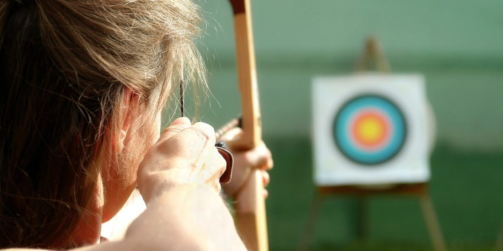 Job seeker aiming at a target to win the job competition.