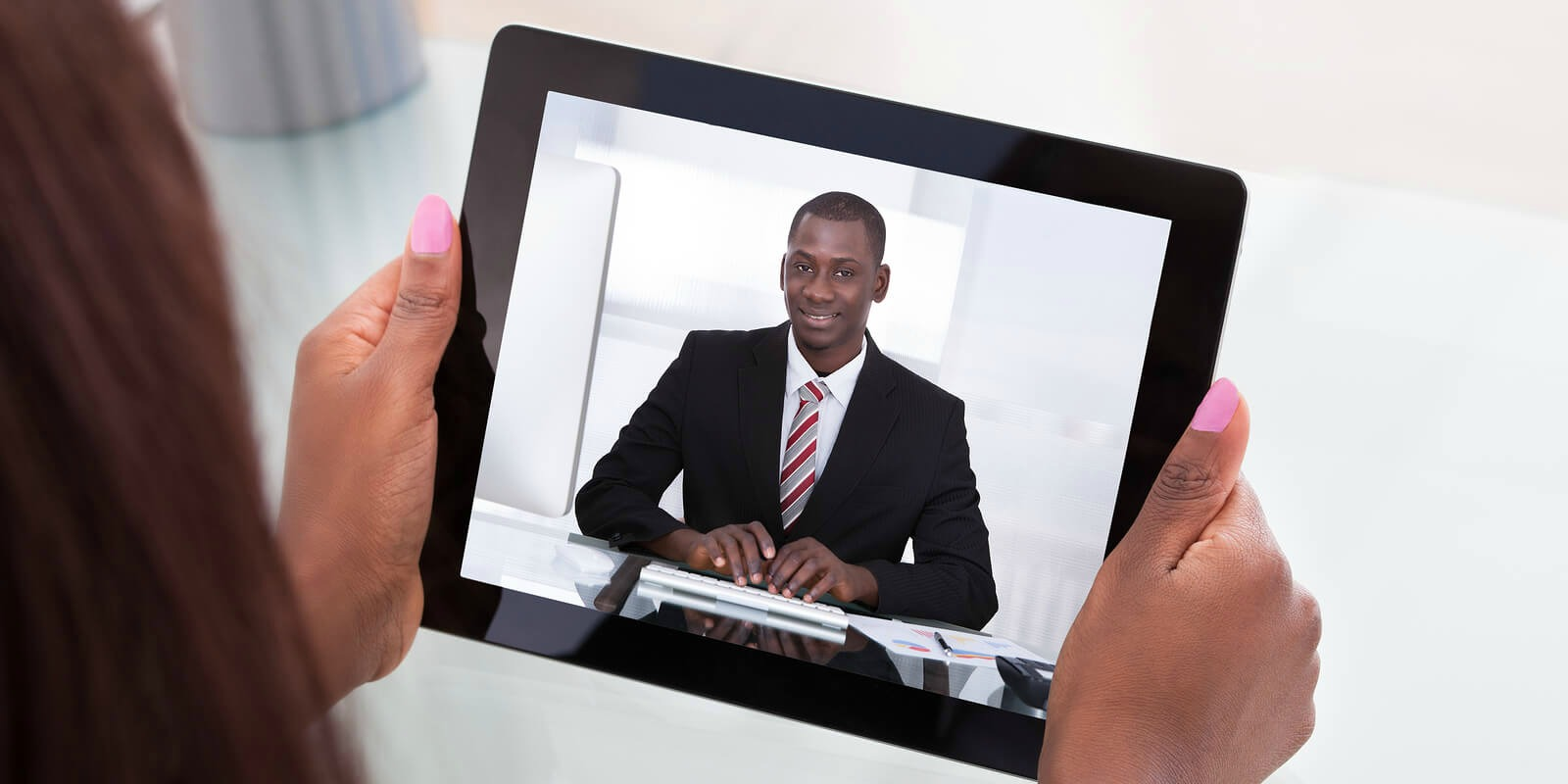 Telecommuting employee who is videoconferencing