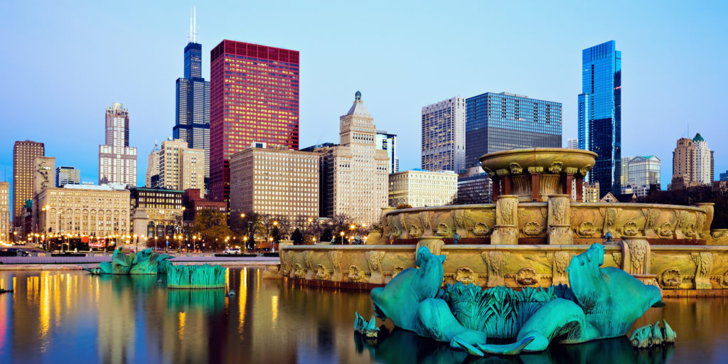 Chicago skyline reflected in Buckingham Fountain., searching for telecommuting jobs in Illinois.