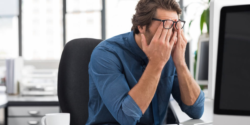 Worker realizing what to hate about work and working in an office.