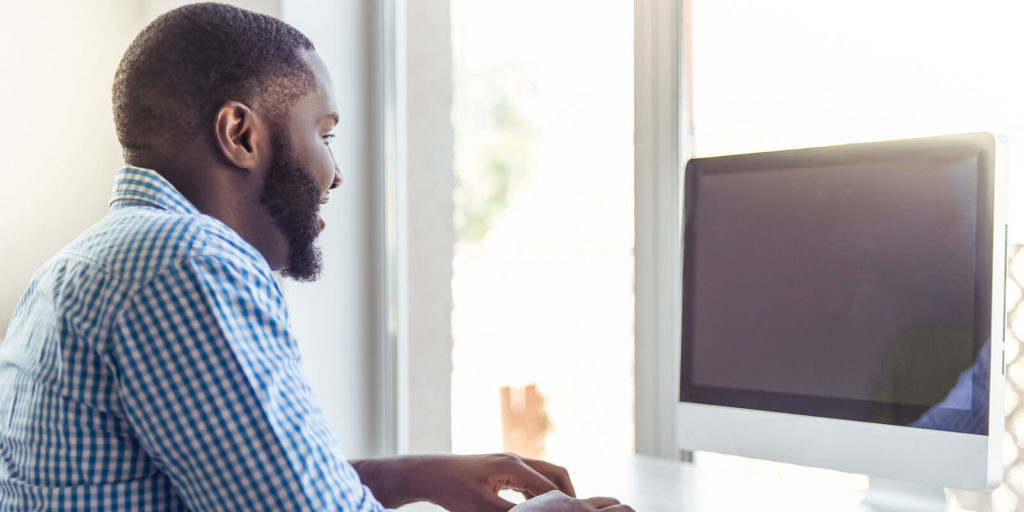 Man looking at awesome employer quotes about work flexibility.