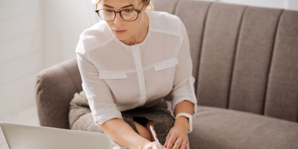 Job seeker checking out interesting jobs with flexible schedules on her laptop.