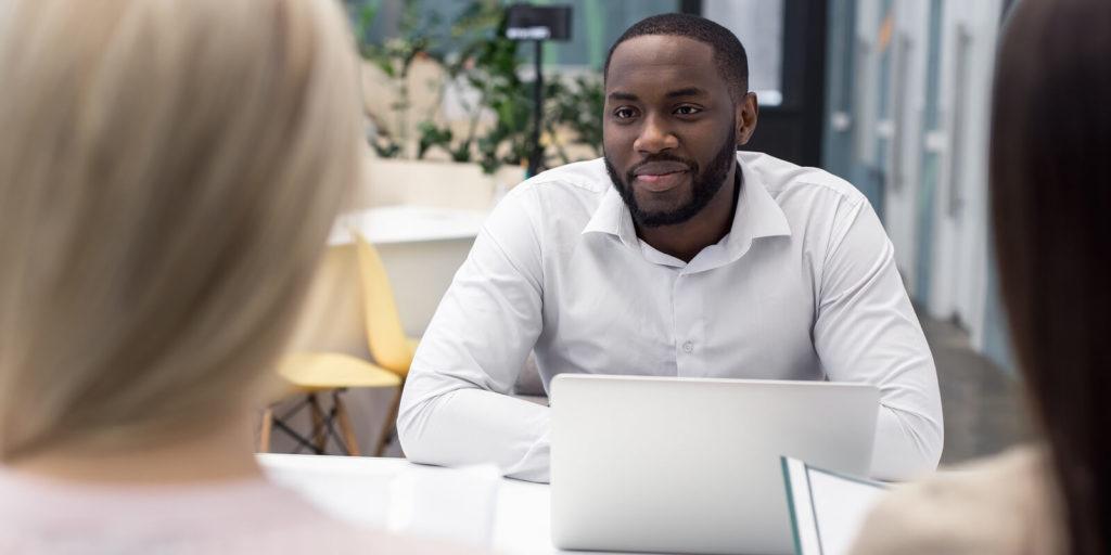 Job seeker following proper job interview etiquette
