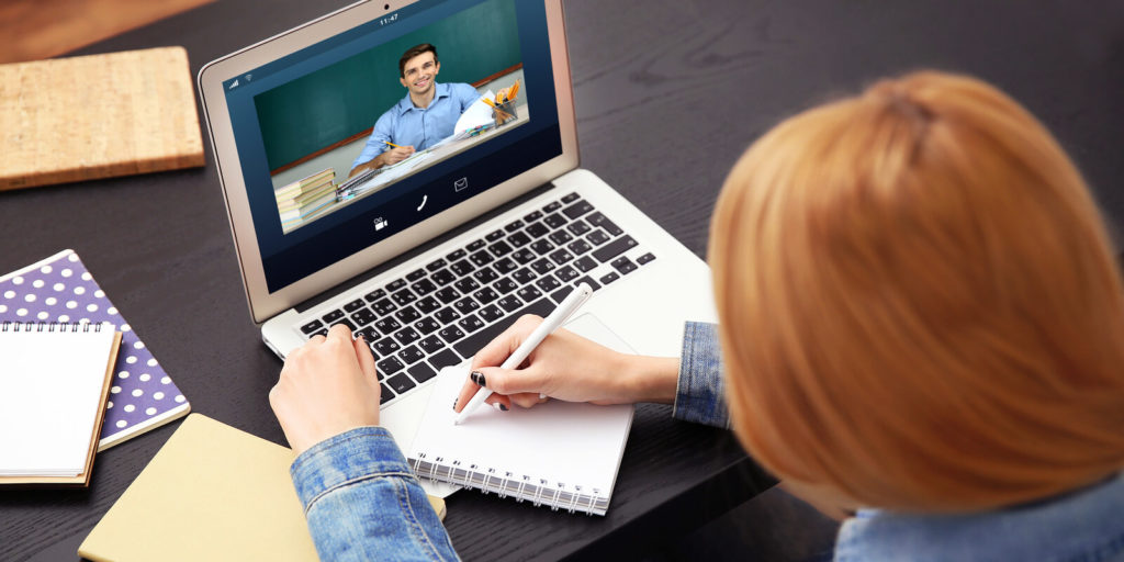 Man with an online tutor job teaching a woman.