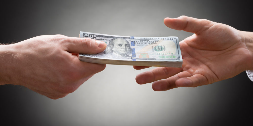 Money exchanging hands to fund a freelancing business.