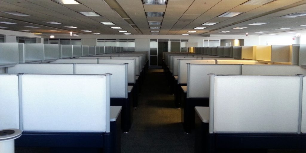 Cubicles in an office filled with cubicle jobs.