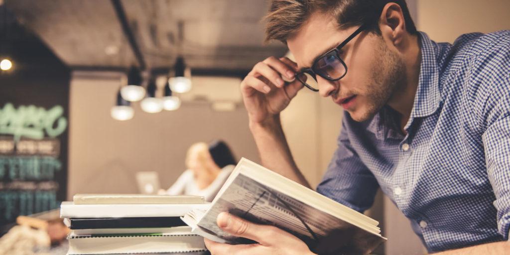 Man reading motivating books.