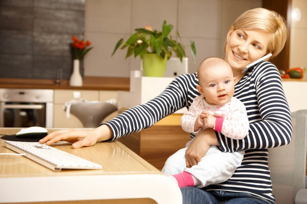 Woman working from home with a kid