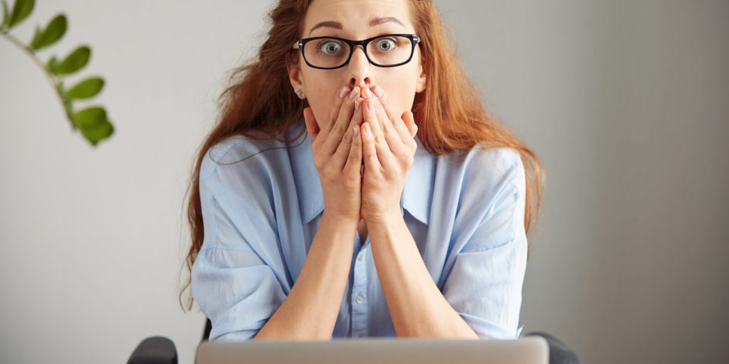 Woman surprised about the facts from the history of working from home.