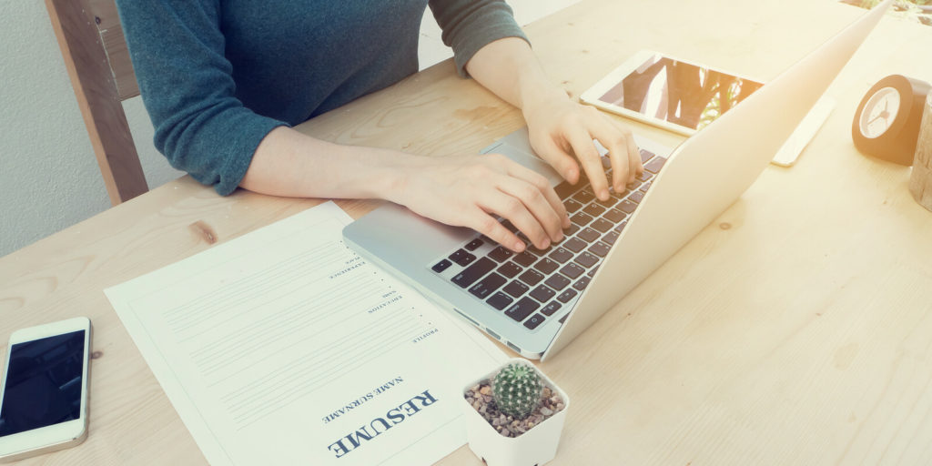 Woman learning to write a better resume