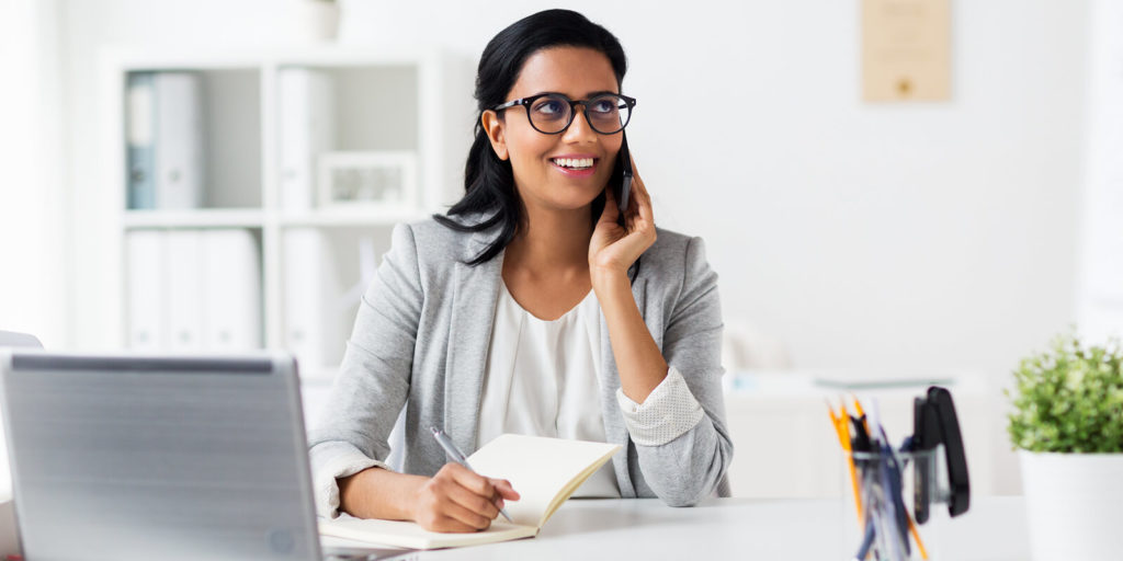 Employee coming up with questions to ask your new boss as a remote worker