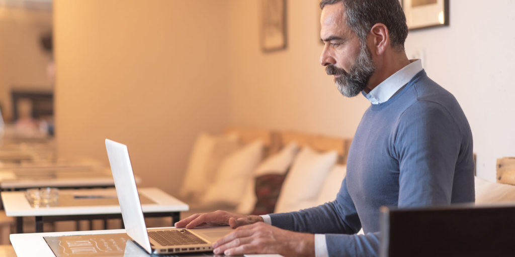 Older man trying to prepare to work remotely