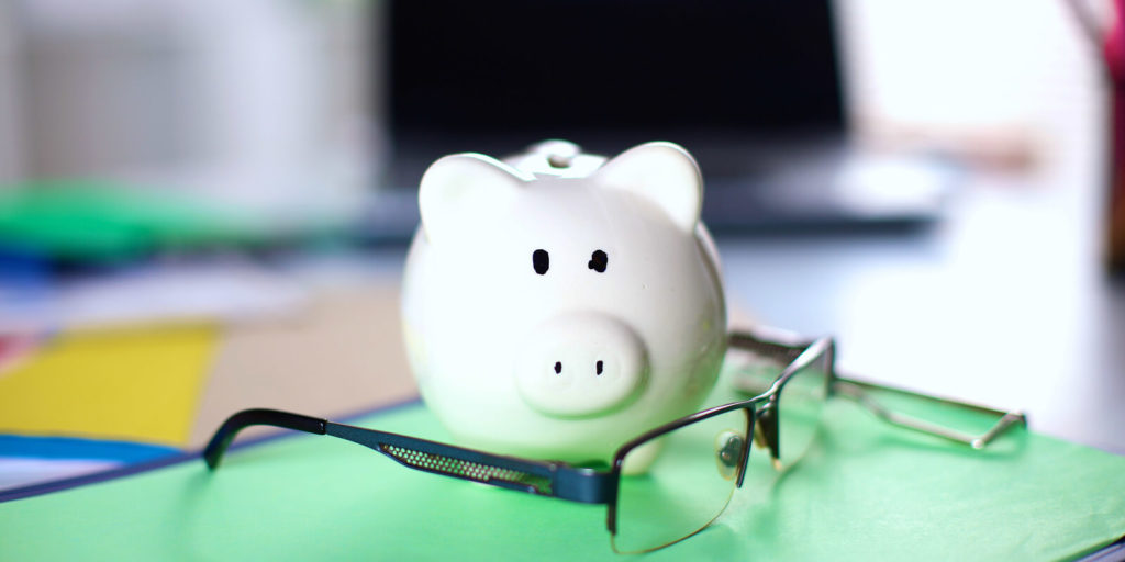 Piggy bank to save money and reduce stress with remote work