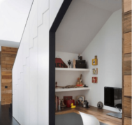A closet office under a staircase